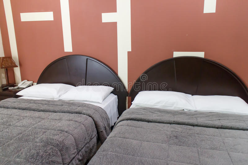 Two beds from a hostel room. Bedroom with two beds, hostel stock images