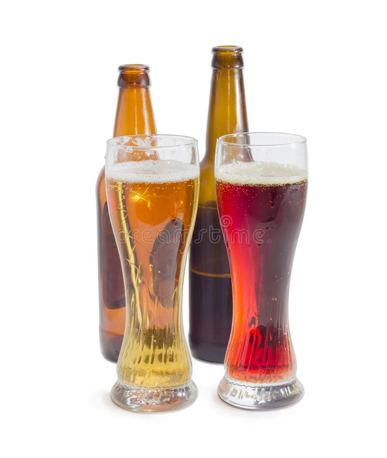 Two beer glasses with lager beer and dark beer royalty free stock photo
