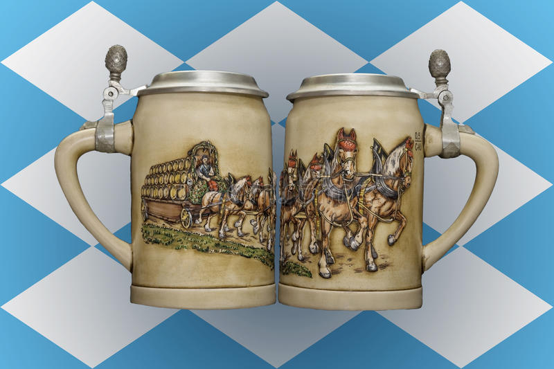 Two beer mugs on the background of the flag of Bavaria. Two old beer mugs on the background of the flag of Bavaria stock photos