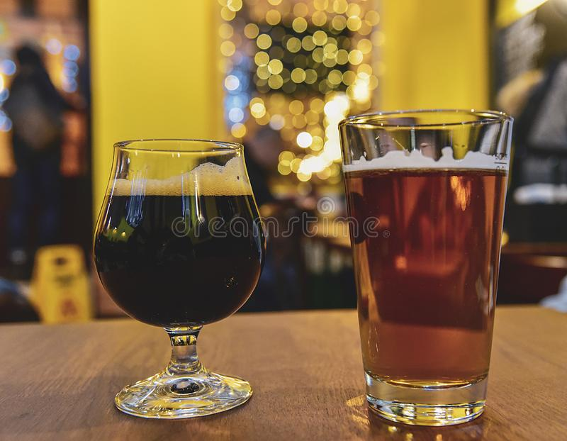 Two Beers, light and dark. In Bar royalty free stock photo