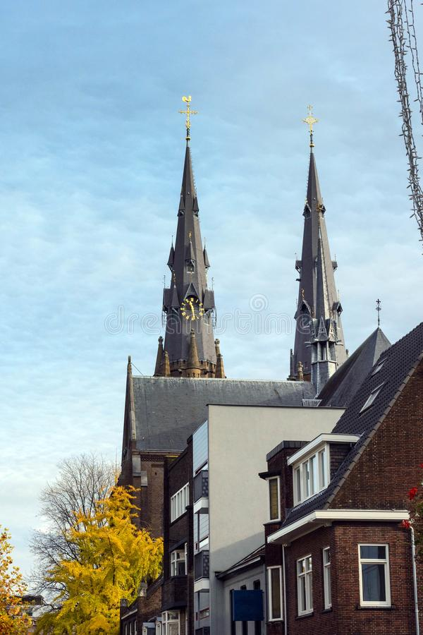Two belfries of the Catholic Church of St. Catherine, Eindhoven, Netherlands. Golden Autumn in Eindhoven.  stock photo