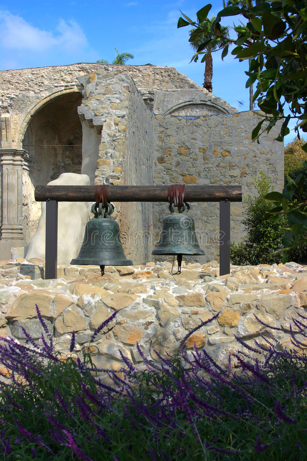 Two Bells hanging at Mission San Juan Capistrano. With the ruins in the background stock photography