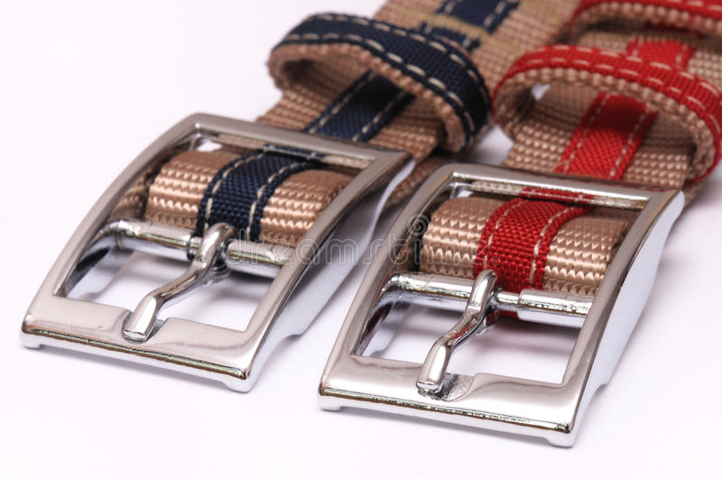 Two Belt Buckles. A photo taken on two belt buckles against a white backdrop royalty free stock images