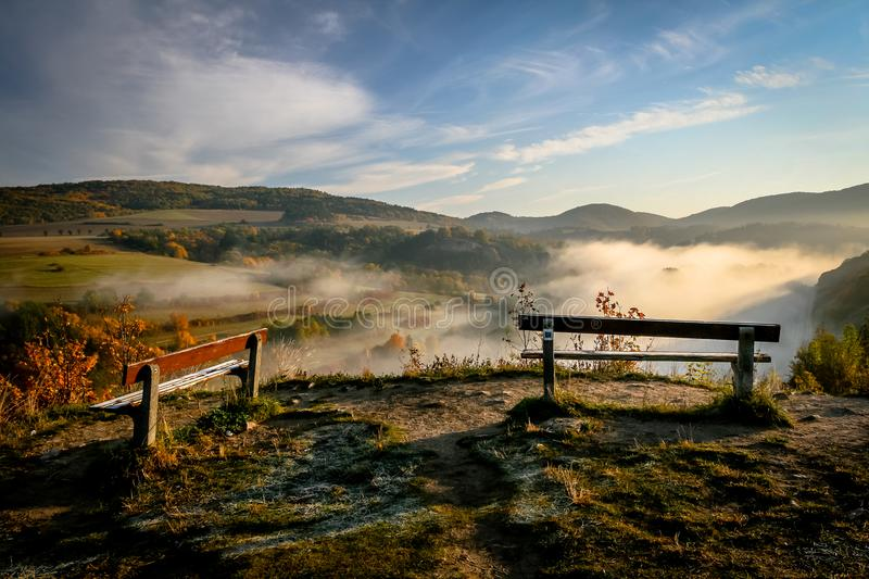 Two Benches in Misty Morning stock photo