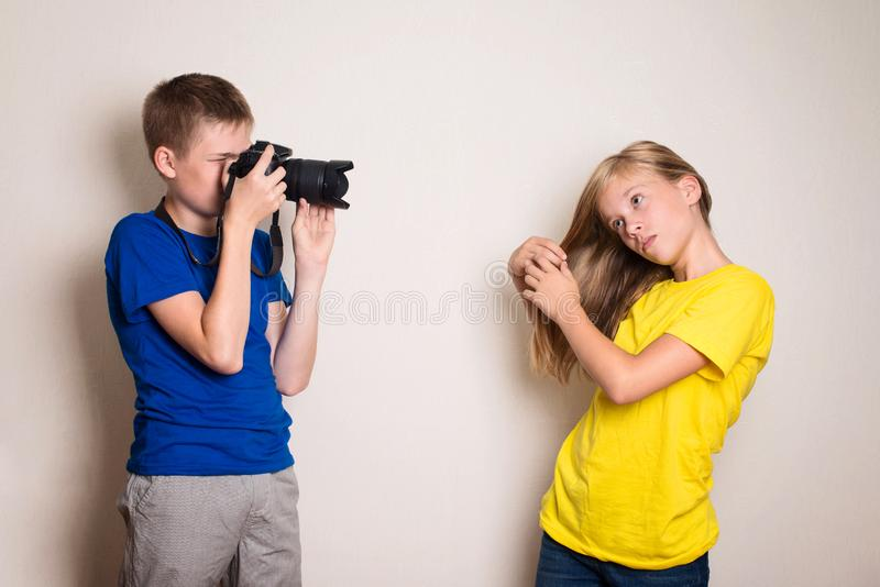 Two best friends teens making photo on their camera at home, having fun together, joy and happiness stock image