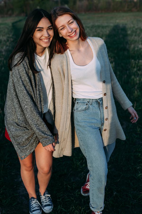 Two best friends walking outdoors stock photos