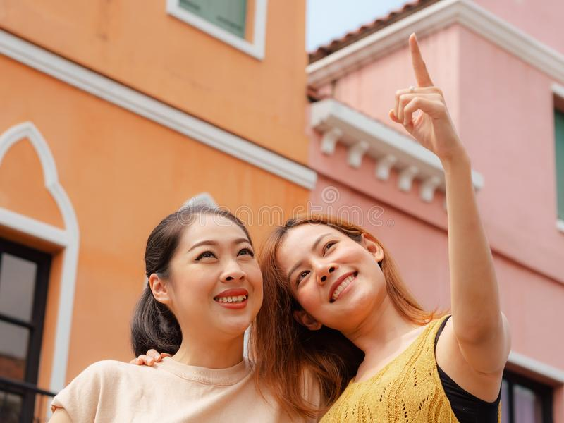 Two best friends women tourists travel in European town. Two Asian best friends women tourists travel in European town royalty free stock photos