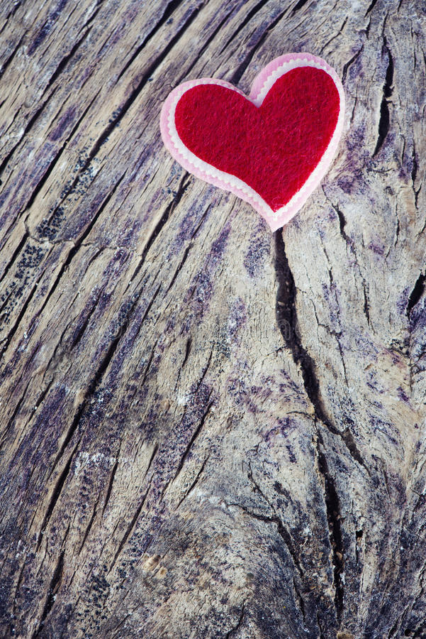 Two beutiful red hearts. Love Valentine`s hearts natural cord and red clips hanging over rustic driftwood texture background stock image