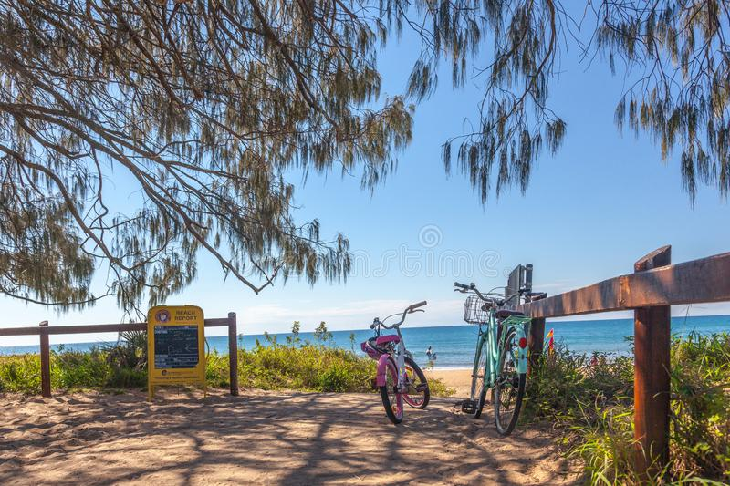 Bicycles at a beach entrance in Agnes Water, Queensland royalty free stock images