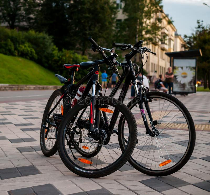 Two bicycles on a city street, bike trip, outdoor activities. Two bicycles on a city street, a bike trip, outdoor activities. A picturesque photo, ideal for a royalty free stock photography