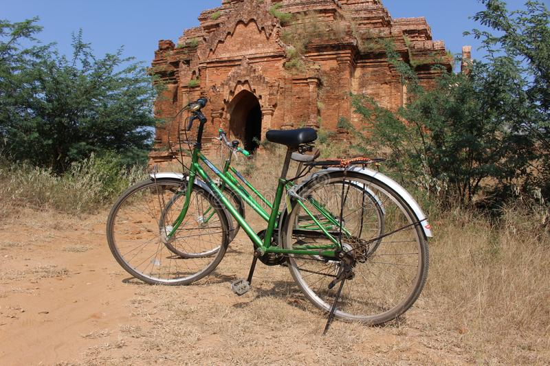 Two bicycles parked in front of temple in Bagan Myanmar stock photography