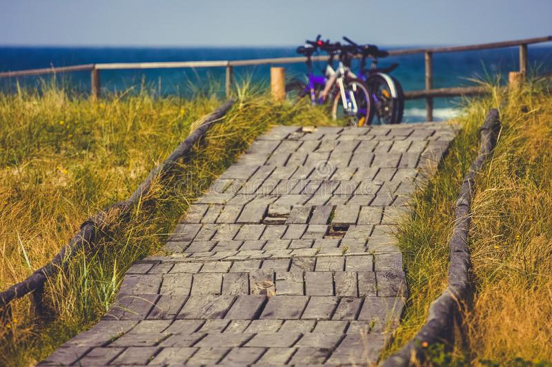 Two bicycles parked on a wooden path along the beach, Curonian Spit stock image