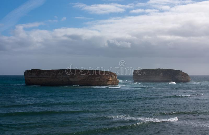 Two big islands off the coast in the Bay of Islands on the Great Ocean Road in Australia. On a sunny day, pacific, victoria, port, campbell, sea, car, white royalty free stock photography