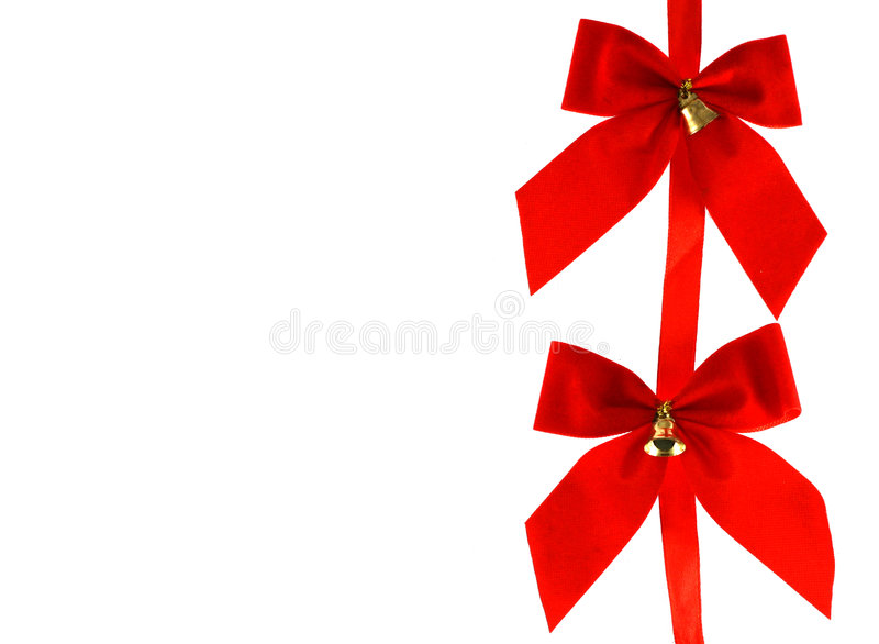 Two Big red holiday bows with bells. On white background stock photos