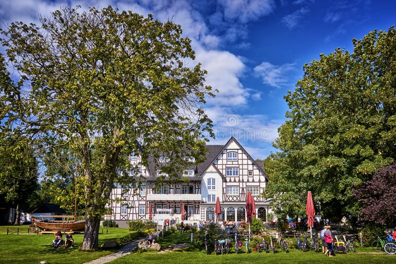 Two big trees Half-timbered house in Kloster on the island Hiddensee. Hotel, building, architecture, tourism, accommodation, amazing, vacation, ancient, street stock photo