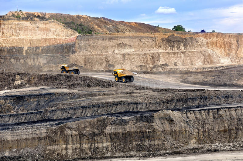 Two big truck on open pit. Hauling marerial overburden, on open pit stock photo