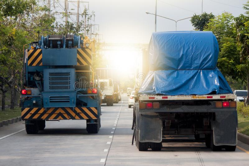 Two big truck transportation. Two big truck transportation on the road for business work stock photography