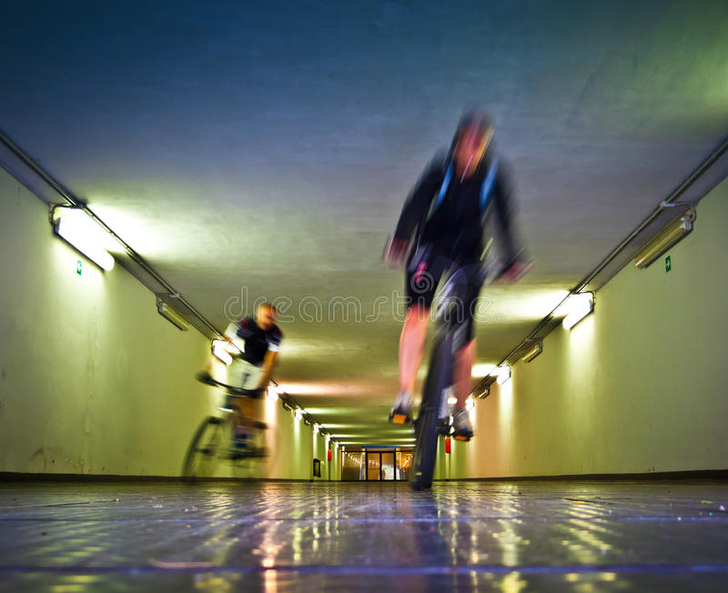 Two bikers in a tunnel royalty free stock photography