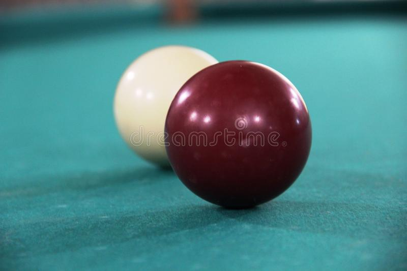 Two billiard balls on green cloth table, cue ball and white ball. russian billiards. Two billiard balls on green cloth table, cue ball and white ball, selective stock photos