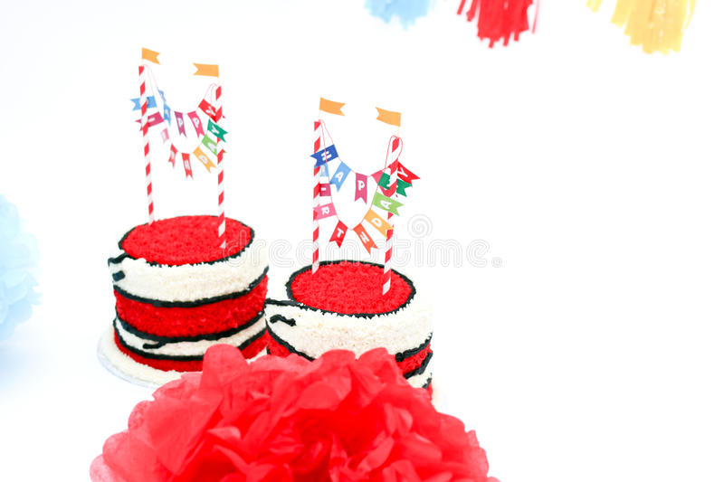 Two birthday cakes with banners. And decorations royalty free stock images