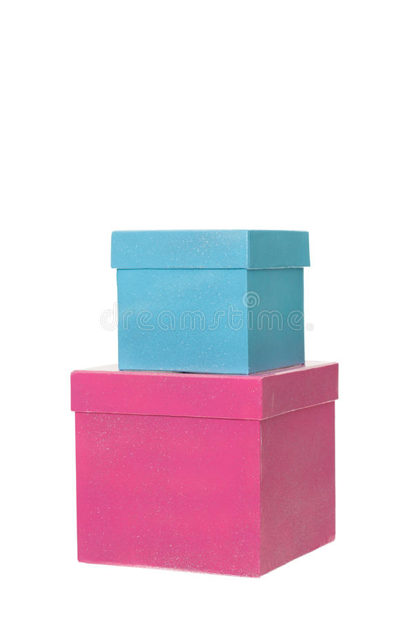 Two Birthday gift boxes in a stack isolated. Two Birthday gift boxes, one pink, one blue, in a stack isolated royalty free stock photos