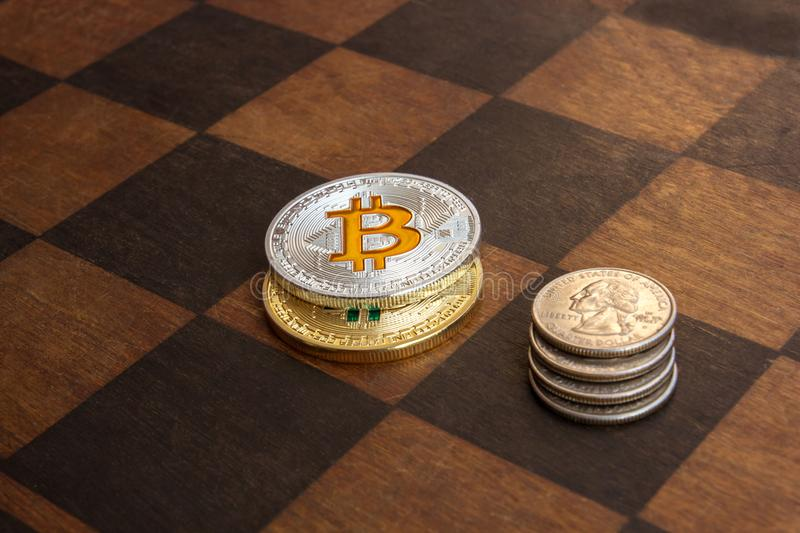 Two Bitcoins and American cents on a chessboard stock images