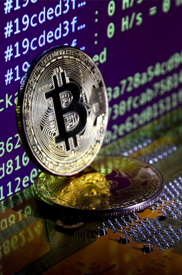 Two bitcoins lies on a videocard surface with background of screen display of cryptocurrency mining by using the GPUs royalty free illustration