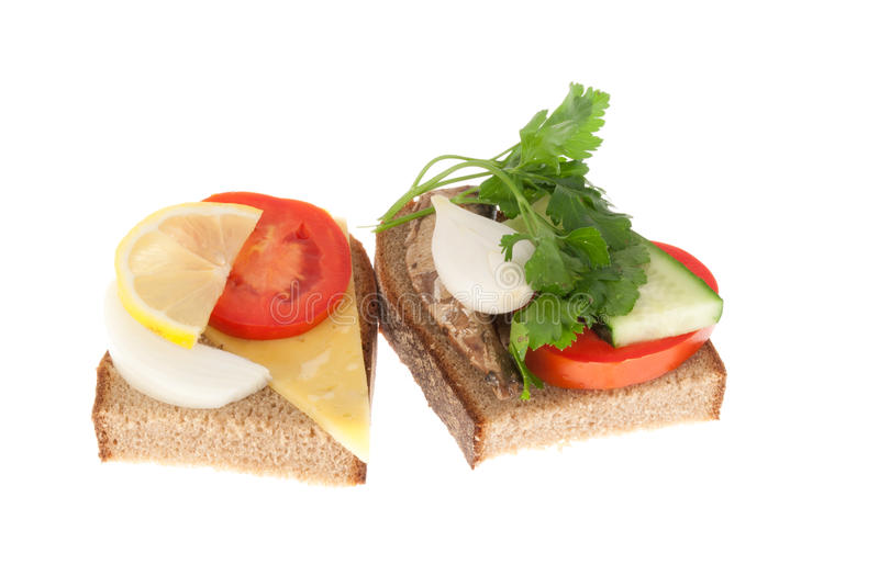 Two bits rye-bread with canned fish and cheese