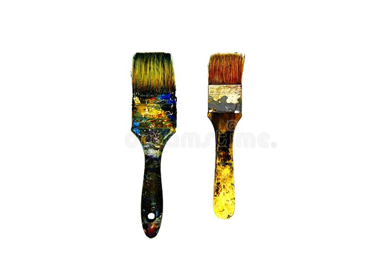 Two Black dirty paintbrush be stained color on isolated white background stock photography