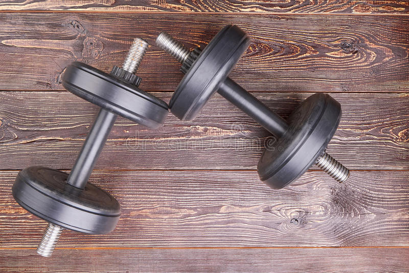 Two black dumbbells, top view. royalty free stock photos
