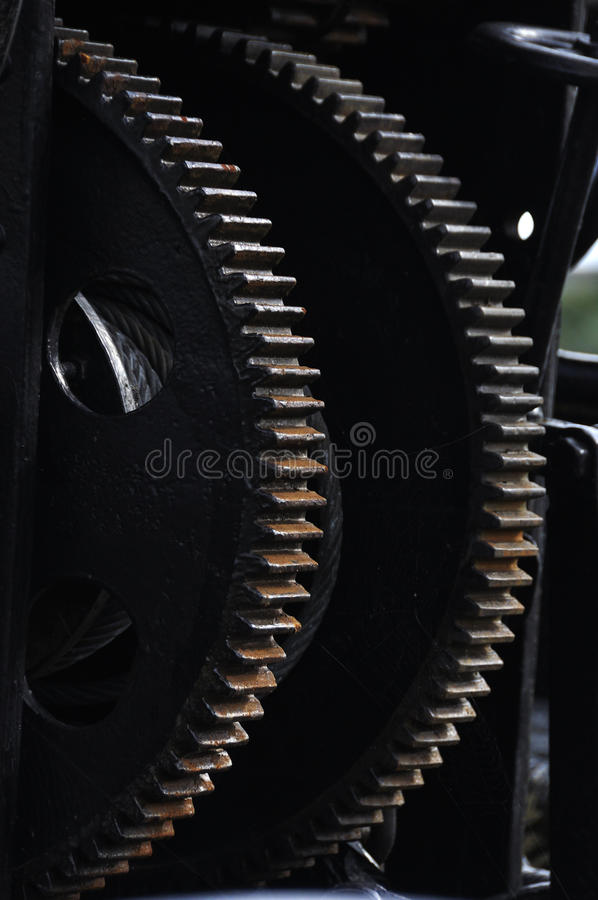 Two black gearwheels. Of a cable winch stock image
