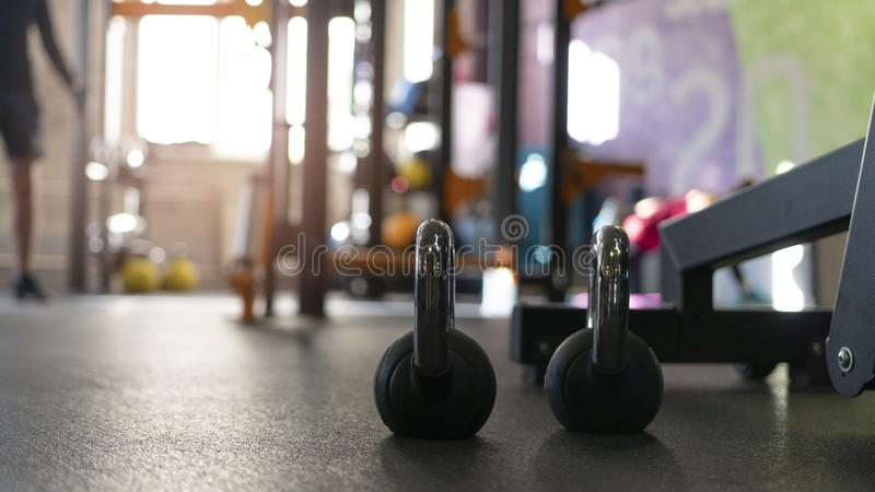 Two black kettlebells on the floor of sport gym stock photo