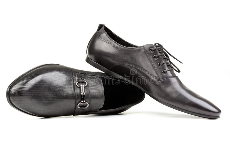 Two black men shoes against white. Background royalty free stock photos