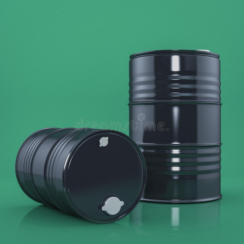 Two black metal barrels on green color background. Front view. Two black metal barrels on green color background royalty free stock photos