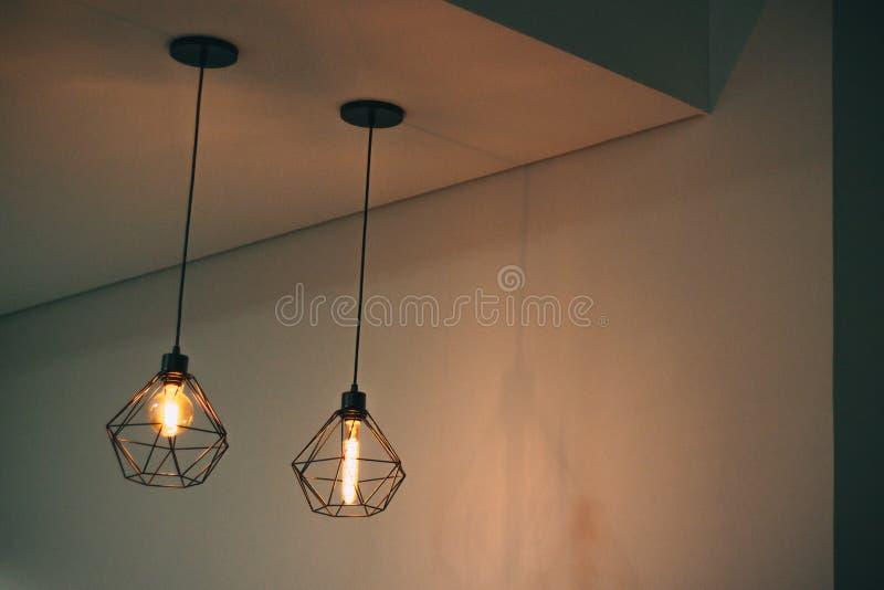 Two Black Pendant Lamp on White Concrete Ceiling royalty free stock photos