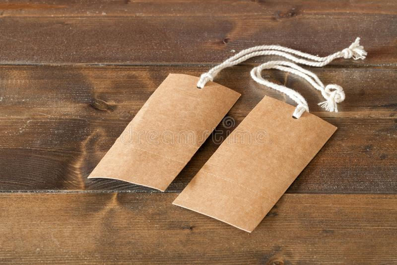 Two blank tags with string ties stock images
