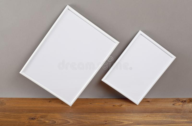 Two blank photo frames for painting or picture on gray background. Two blank photo frames for painting or picture on gray background royalty free stock images