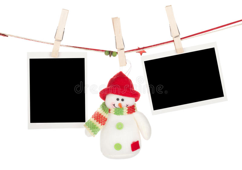 Two blank photos and snowman hanging on the clothesline stock images
