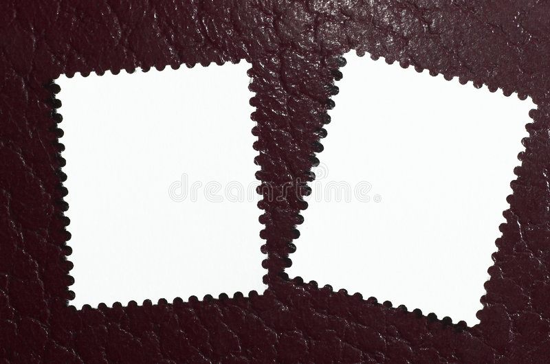 Two blank stamps on a red leather background stock photos