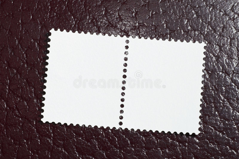 Two blank stamps on a red leather background stock images