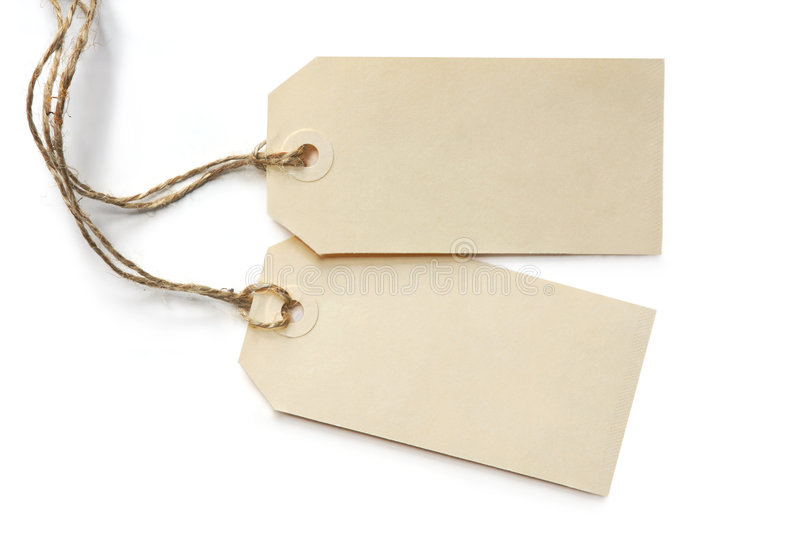 Two Blank Tags. Tied with string, reflected on white surface royalty free stock photo