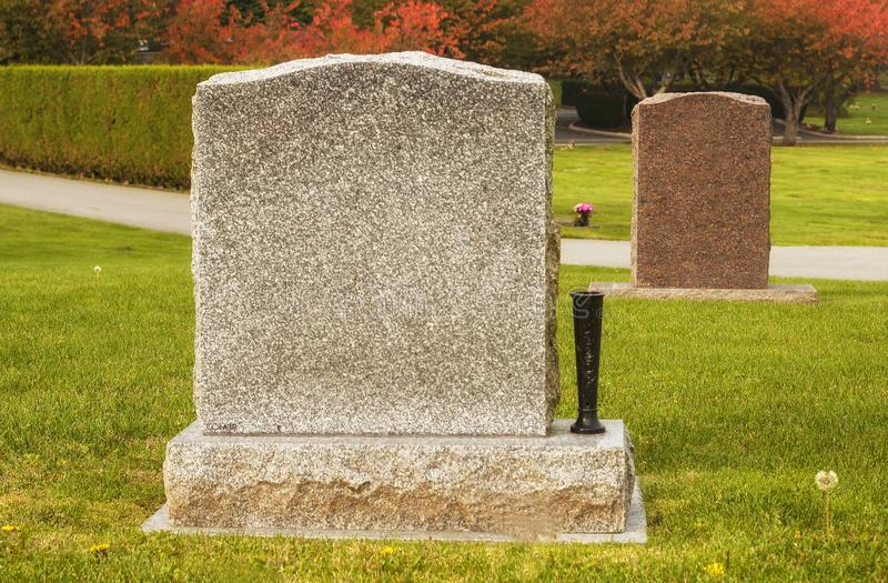 Two blank tombstones in an attractive cemetery royalty free stock photos
