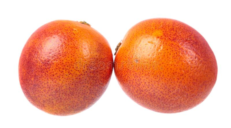 Two blood oranges isolated on white background royalty free stock photo