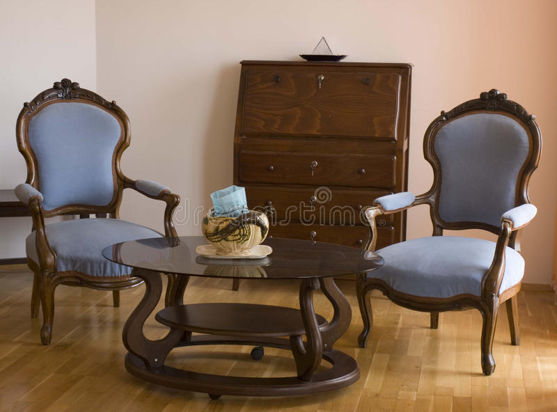 Two blue chairs in the living room royalty free stock image