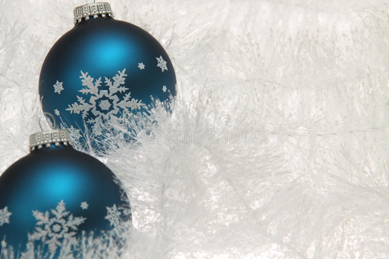 Two blue christmas baubles with snowflakes