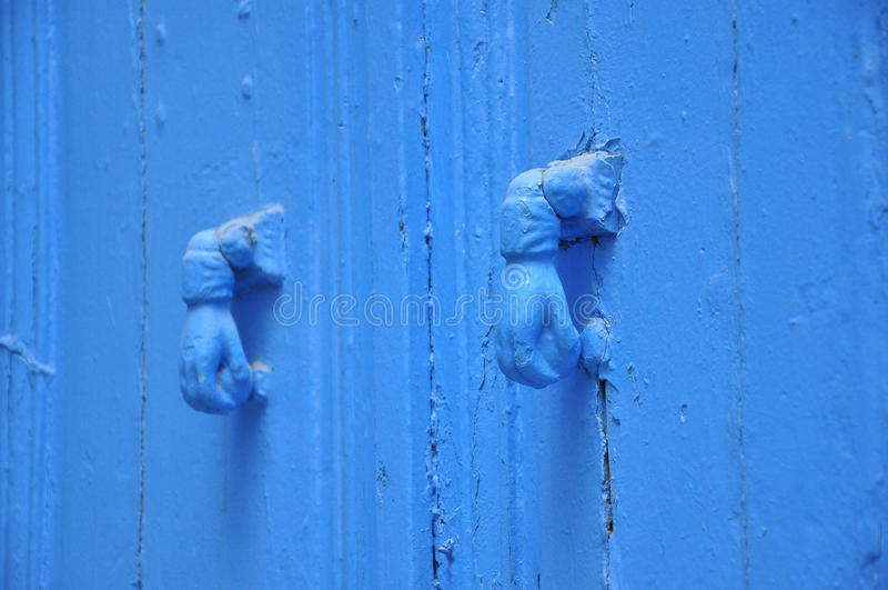 Two blue knockers hand design, Tunisian blue door. Blue knocker- hand design on Tunisian blue door, typical for the medina, amazing traditional architecture stock photography
