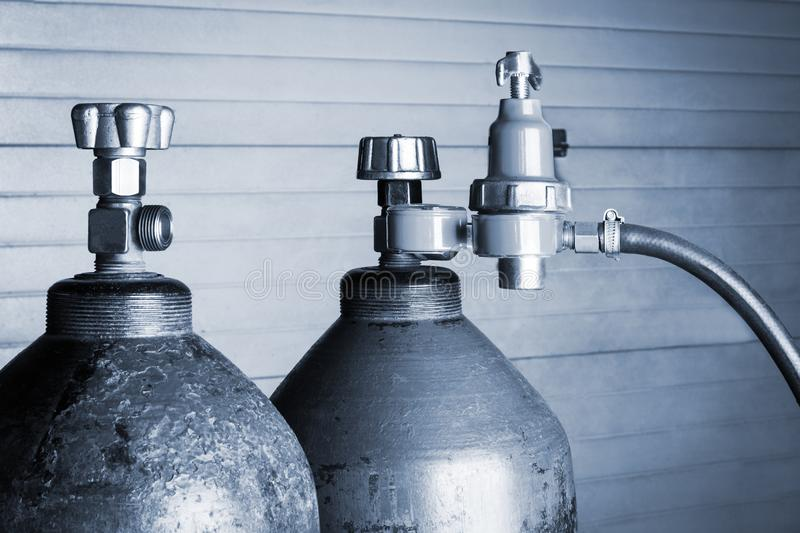 Two oxygen cylinders. Two blue oxygen cylinders close up royalty free stock image