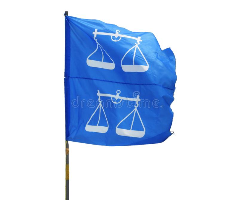 Two BN Flags Fluttering In The Wind Isolated. Two flags from the Malaysian coalition political party, Barisan Nasional BN mounted on a PVC pole and fluttering in royalty free stock image