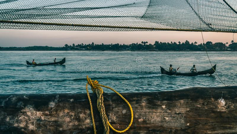 Two boat and Chinese fishing nets at Fort Kochi, Kerala, India stock images