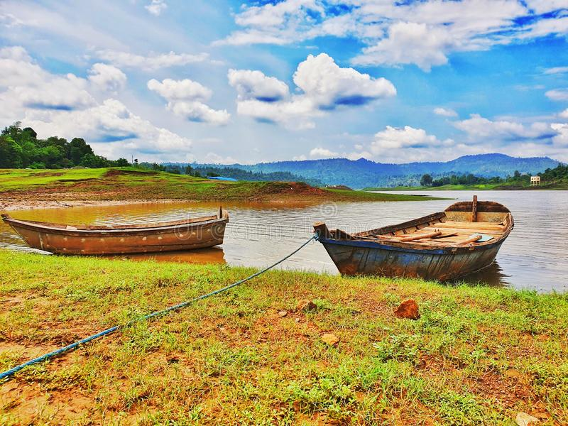 Two boats on beautiful lake and blue sky royalty free stock images